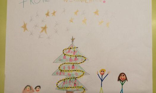 Weihnachtsbild von einer Familie um den Weihnachtsbaum