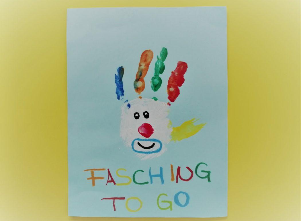 """Ein Clown aus einem Handabdruck mit der Aufschrift """"Fasching to go"""""""